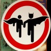 Superheroes Batman and Robin in Road sign image