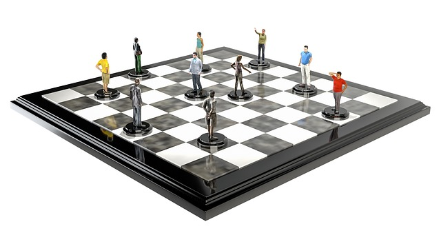 Brain and Executive function Black and white chessboard with miniatures of people as chess pieces