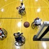 4 players on basketball court in wheelchairs