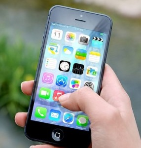 Brain injury in the 21st century Iphone with hand using icons on face of phone