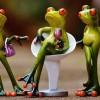 Brain Injury and Fundamental Attribution Error Cartoon of three green frogs holding drinks and handbag