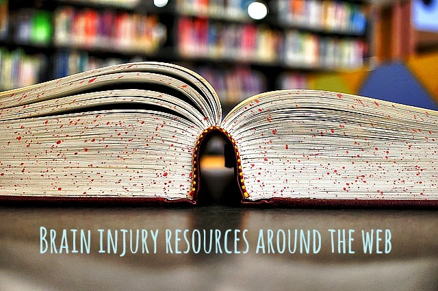 Brain Injury Resources Photo of an open book with shelves of books behind.