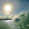 End of life and dying. Close up photo of a wave breaking with sun behind