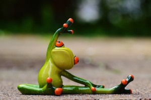 Fatigue after brain injury Cartoon of frog in gymnastic pose.