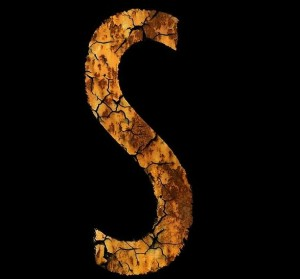 Letter S in glass. Damage to the brain