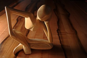 Impulsivity after brain injury Carved wooden figure in thinking pose
