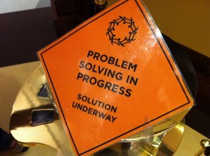 Brain Injury Planning and Problem solving Orange label with the words Problem Solving in Progress. Solution underway