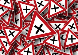 Strategies for Brain Injury - photo of crosses within red and white triangle
