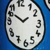Taskbuster Painted clock on blue background