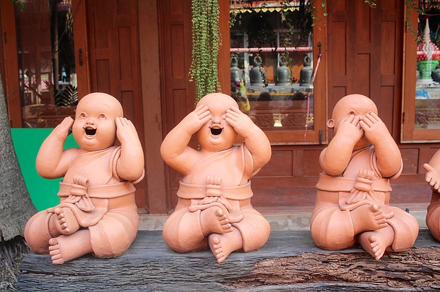 To Say or Not to Say Brain Injury. Photo of 3 Buddha statues one each with hand over mouth, ears, eyes