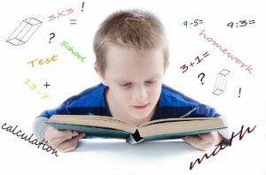 Unusual outcomes brain injury. Photo boy in blue tshirt reading book with equations as background
